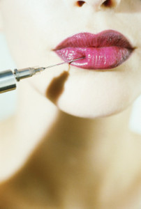 Young woman having collagen injection in lips --- Image by © Crisco/Corbis
